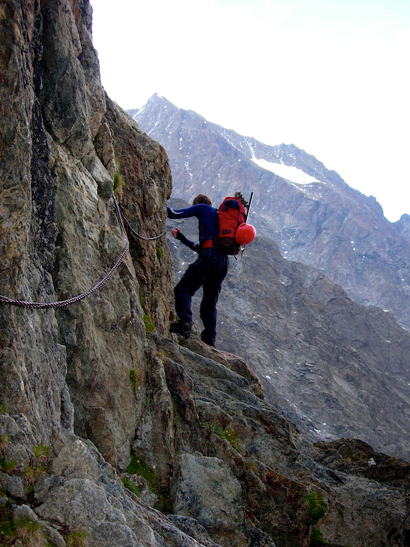 James climbing up the cables to the refuge