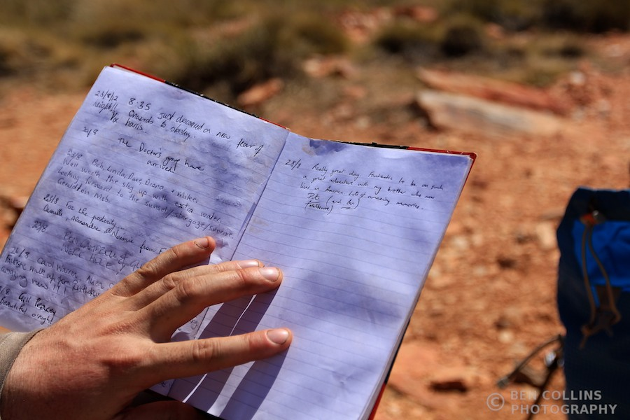 Signing the summit register on Brinkley Bluff, Larapinta Trail, Australia