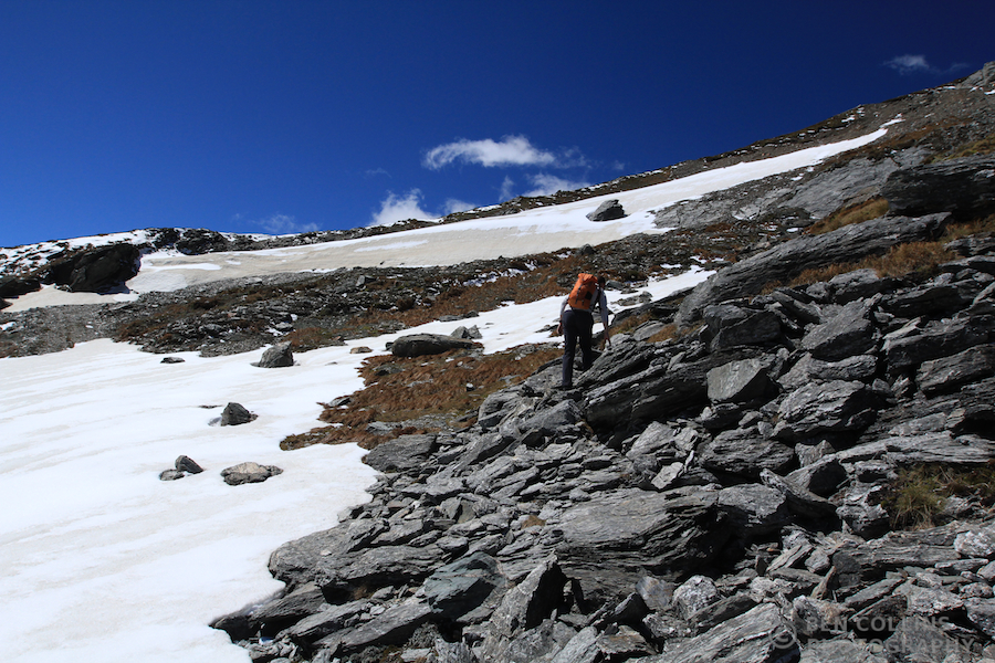 Climbing over the snowfields near the summit
