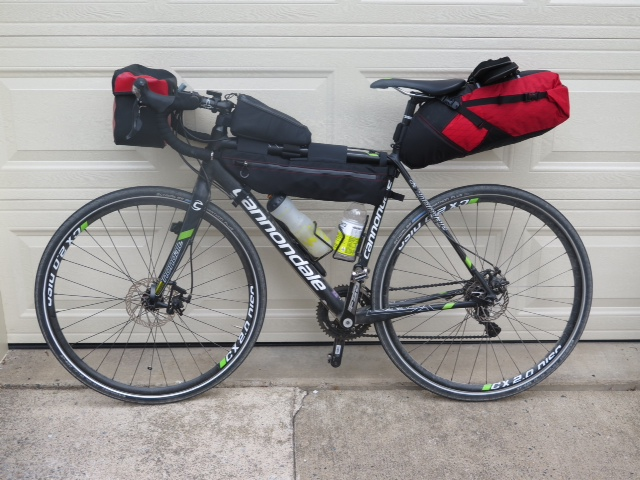 Cyclocross bike setup with Revelate bags, bar bag and touring tyres