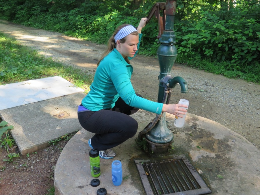 Lexi drawing up water from the well