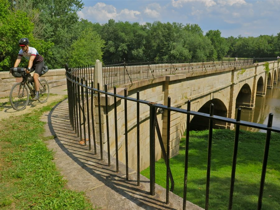 Cycling past an historic canal aqueduct